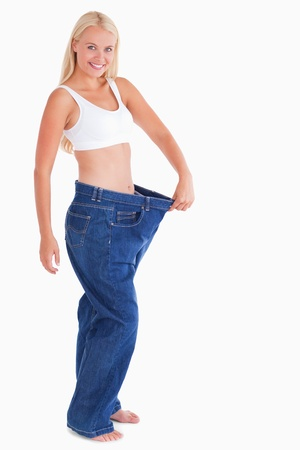 Charming woman wearing jeans that are too big Stock Photo - 11206506