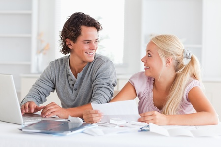 Surprised couple doing their accounts in the living room photo
