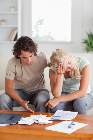 Stressed couple on a sofa in the living room photo