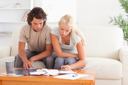Working couple sitting in the living room photo