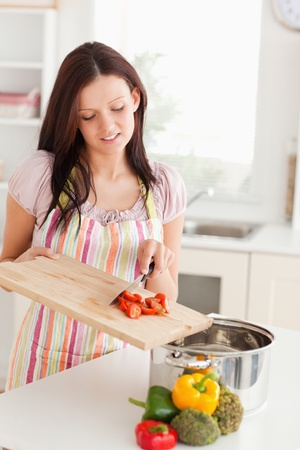 woman cooking: A woman is preparing food for cooking Stock Photo