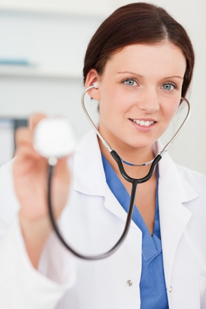 auscultate: A pretty female doctor with a stethoscope
