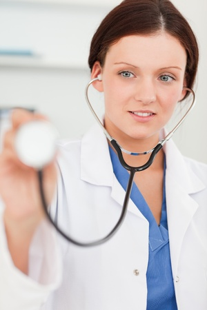 A female doctor using a stethoscope Stock Photo
