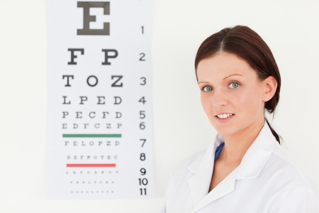 A female optician with an eye test photo