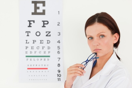 A pretty female optician with an eye test Stock Photo - 11225462