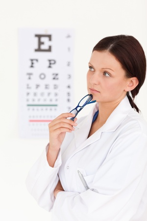 A beuatiful female optician with an eye test Stock Photo - 11207393