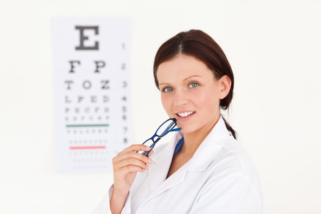 A kind female optician with an eye test Stock Photo - 11207491