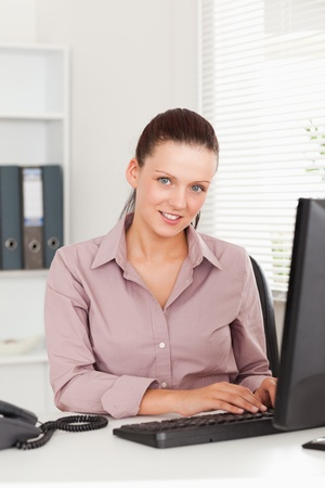 A kind businesswoman in her office Stock Photo - 11228684
