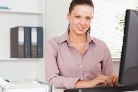 A nice businesswoman sitting in her office photo