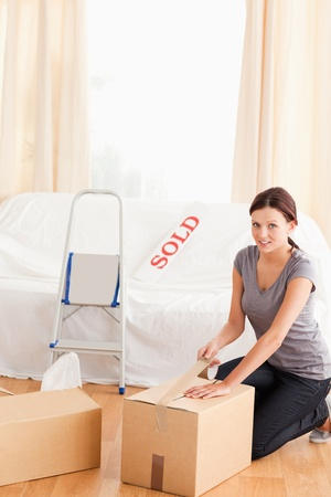A woman is preparing cardboards for transport Stock Photo - 11231818