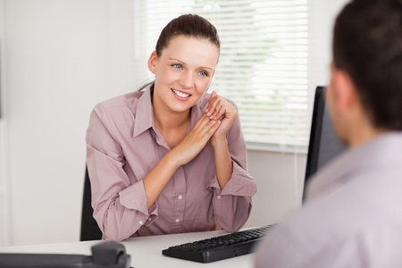 councilor: A businesswoman is talking with a customer Stock Photo