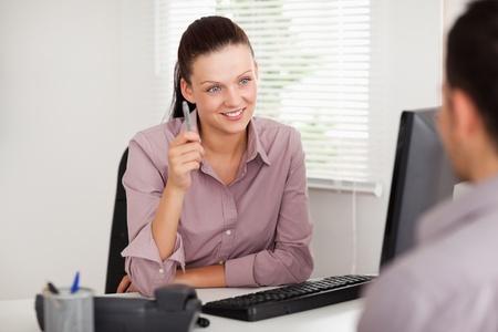 councilor: A businesswoman listens to a customer