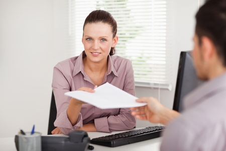A businesswoman gives a customer a contract photo