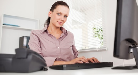 A businesswoman working in her office Stock Photo - 11207717