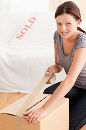 A female is preparing a cardboard for the transport Stock Photo - 11192087