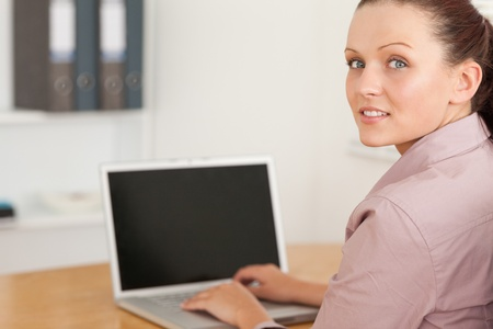 A businesswoman at her laptop photo
