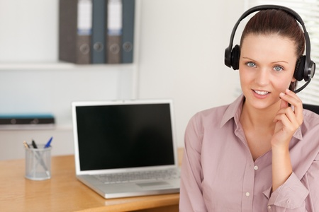 An operator with headset by laptop photo