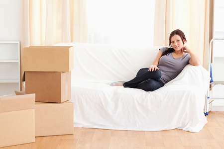 Cute woman sitting on a couch in a living room photo