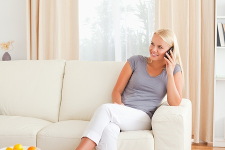 Woman on the phone in her living room photo