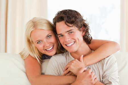 Cute couple hugging in their living room Stock Photo - 11226732
