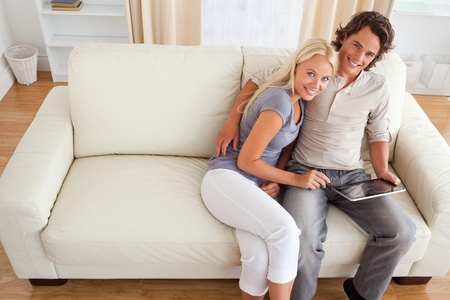 Couple with a tablet computer in their living room photo