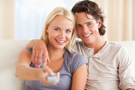 Close up of a cute couple watching TV in their living room Stock Photo - 11226836