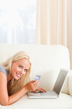 Portrait of a smiling woman purchasing online in her living room Stock Photo - 11211995