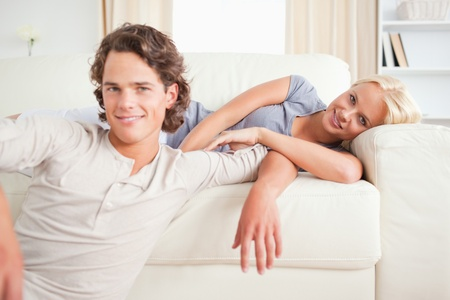 Couple posing in their living room while looking at the camera photo