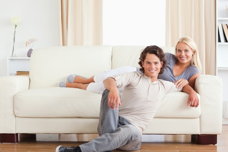 Cute couple posing in their living room photo