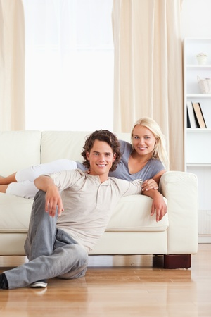 Portrait of a couple posing in their living room photo