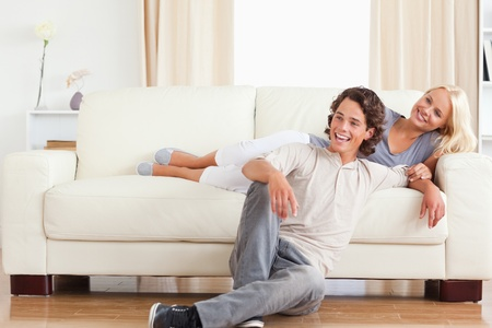 Laughing couple posing in their living room Stock Photo - 11228703