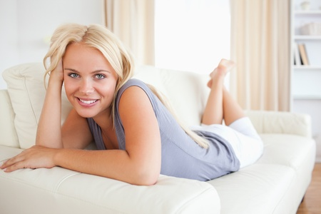 Lovely woman lying on her sofa photo