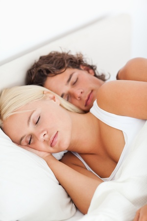Young couple sleeping in their bedroom photo