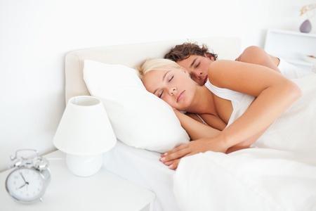 Quiet couple sleeping in their bedroom photo