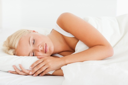 Calm woman sleeping in her bedroom photo