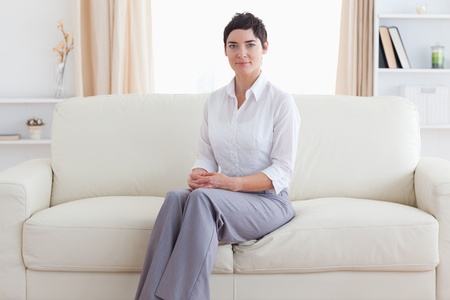 Woman sitting on a sofa in a living room photo