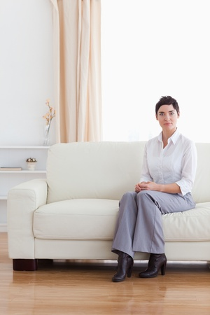 Brunette businesswoman waiting in a living room photo