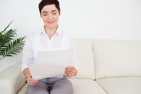Charming woman with a paper in a waiting room photo