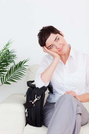 Beautiful Businesswoman with a bag in a waiting room photo