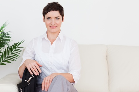 Gorgeous Businesswoman with a bag in a waiting room photo