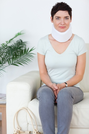 Woman with a surgical collar in a waiting room photo