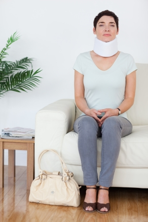 Injured Woman with a surgical collar in a waiting room photo