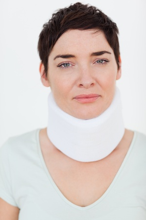 Close up of a Injured Woman with a surgical collar in a waiting room photo