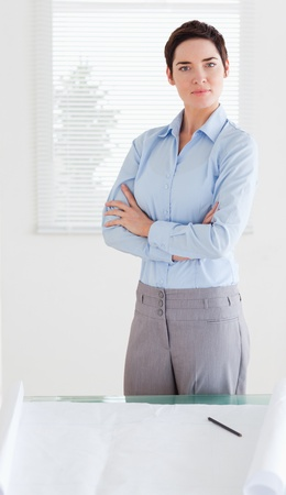 Serious businesswoman with a architectural plan in an office Stock Photo - 11226596