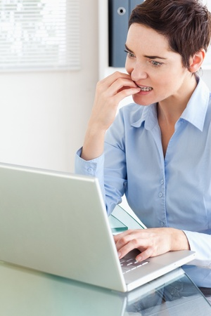 Angry businesswoman with a laptop in an office photo