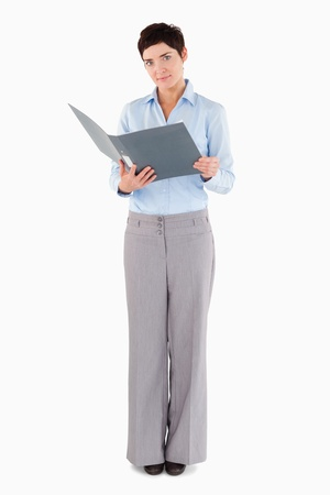 Businesswoman holding a binder against a white background photo