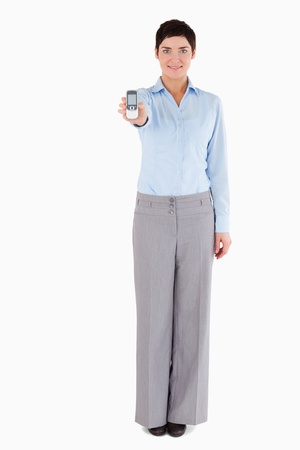 Woman showing a mobile phone against a white background Stock Photo - 11227890