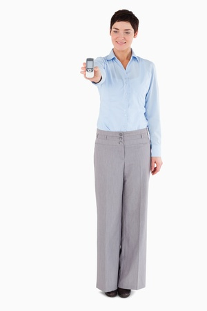 Businesswoman showing a mobile phone against a white background Stock Photo - 11227876