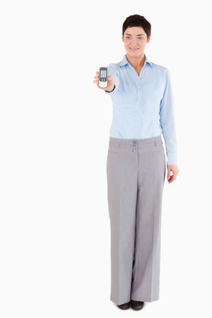 Businesswoman showing a cellphone against a white background Stock Photo - 11227572