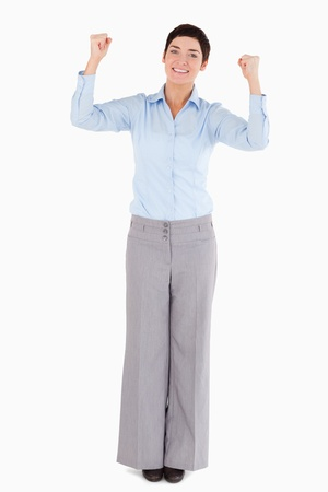 Businesswoman with the fists up against a white background photo